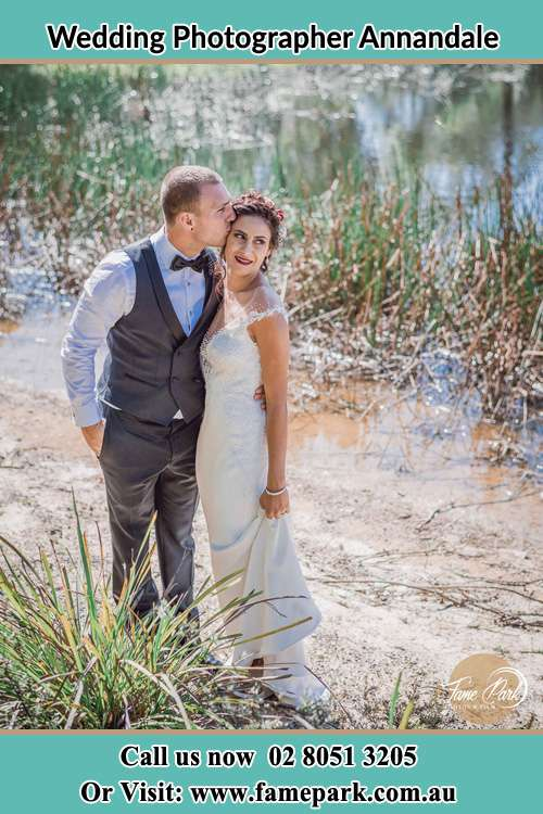 Photo of the Groom kiss the Bride near the lake Annandale NSW 2038