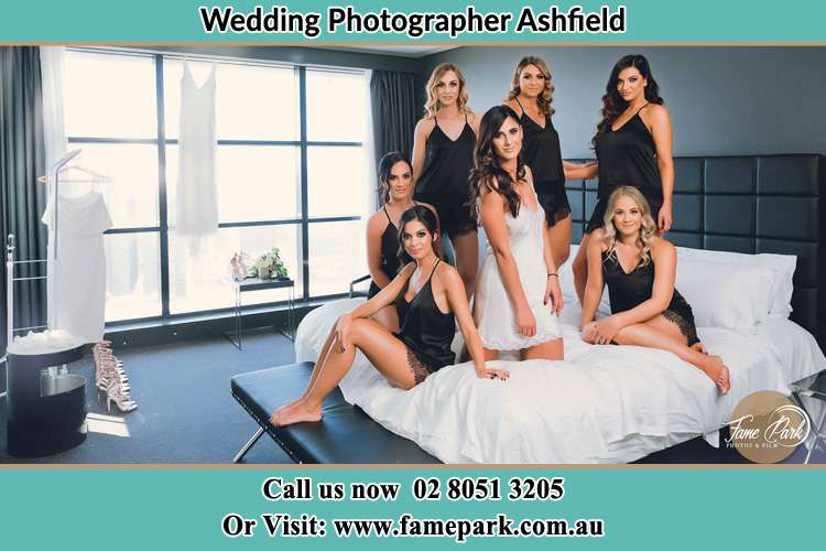 Photo of the Bride and the bridesmaids wearing lingerie on bed Ashfield NSW 2131