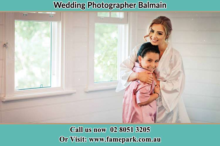 Photo of the Bride hugging the flower girl Balmain NSW 2041