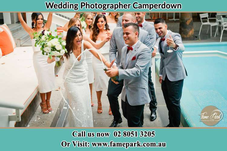 Photo of the Groom and the Bride celebrating with the secondary sponsors Camperdown NSW 2050