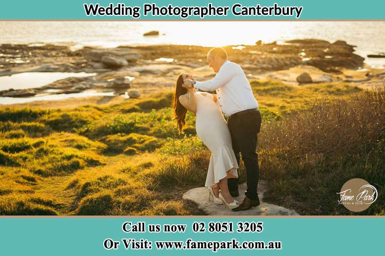Photo of the Bride and the Groom dancing near the lake Canterbury NSW 2193