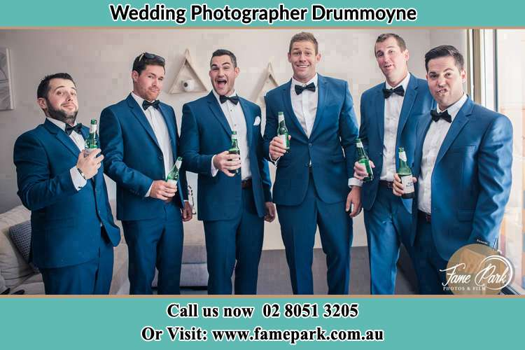 The groom and his groomsmen striking a wacky pose in front of the camera Drummoyne NSW 2047
