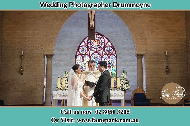 Photo of the Bride and Groom at the Altar with the Priest Drummoyne NSW 2047
