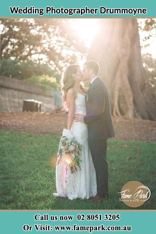 Photo of the Bride and the Groom kissing at the yard Drummoyne NSW 2047