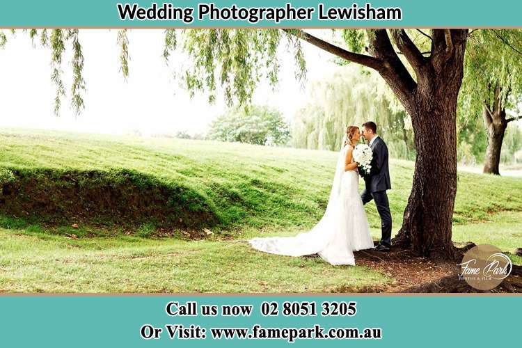 Photo of the Bride and the Groom kissing under the tree Lewisham NSW 2049