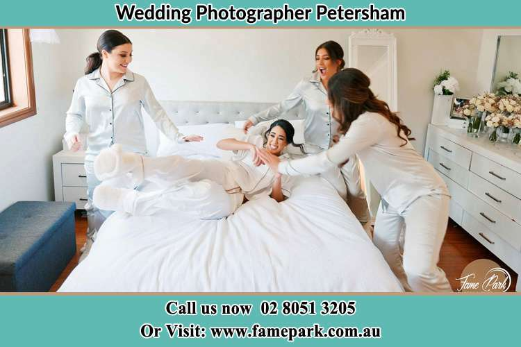 Photo of the Bride and the bridesmaids playing on bed Petersham NSW 2049