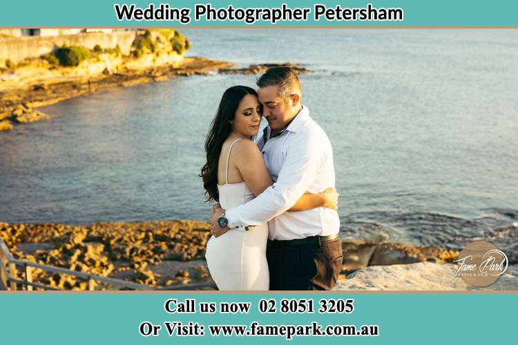 Photo of the Bride and the Groom hugging near the lake Petersham NSW 2049