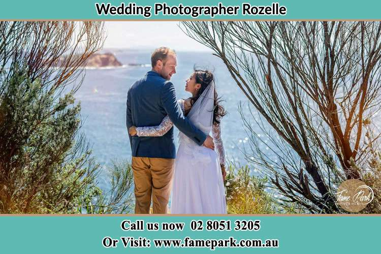 Photo of the Groom and the Bride looking each other near the sea front Rozelle NSW 2039