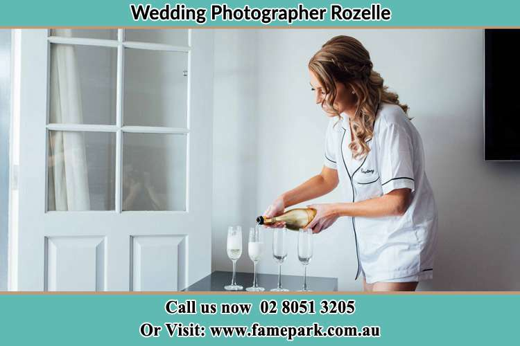 Photo of the Bride pouring wine to the glasses Rozelle NSW 2039