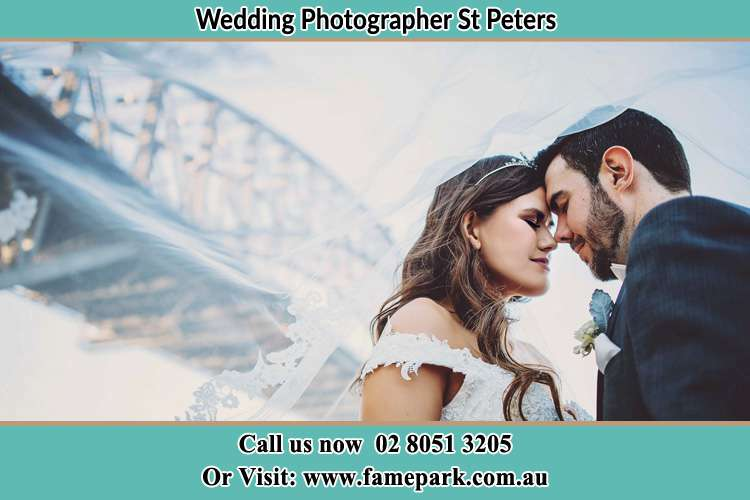 Close up photo of the Bride and the Groom under the bridge St Peters NSW 2044