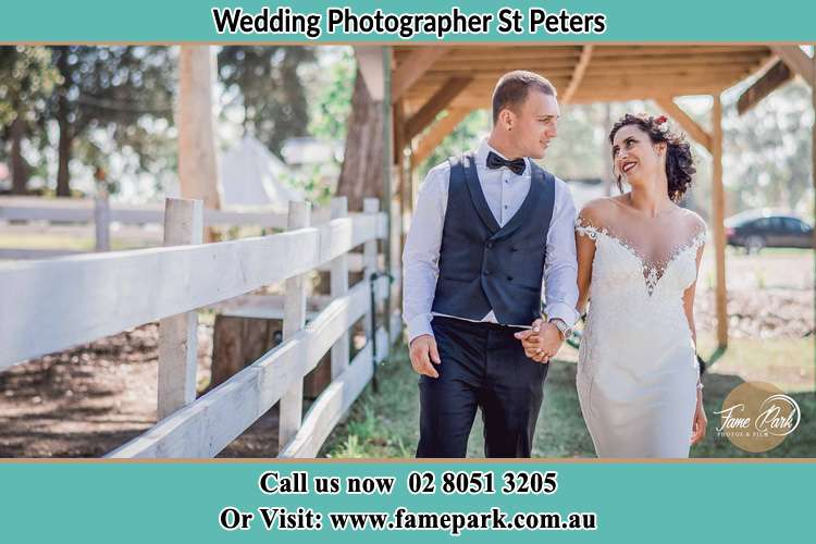 Photo of the Groom and the Bride holding hands while walking St Peters NSW 2044